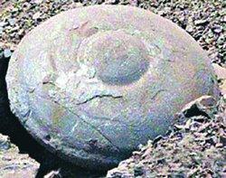 Каменный диск в форме летающей тарелки
